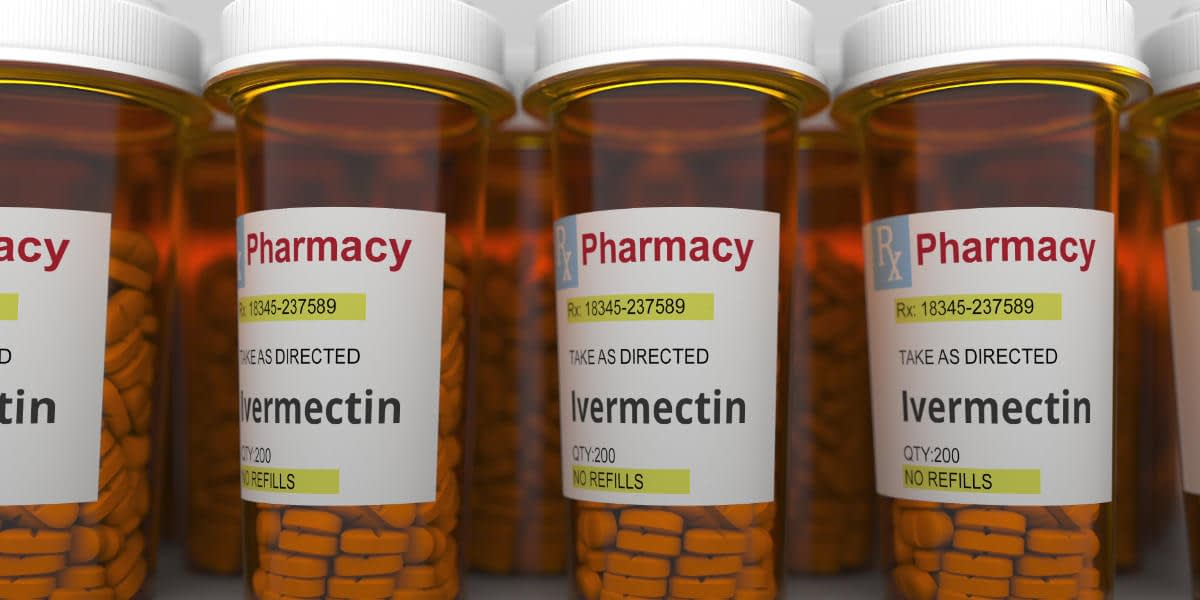 Pharmacy vials with ivermectin generic drug pills as a possible coronavirus disease treatment. 3D rendering
