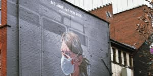 Portrait of NHS worker on wall